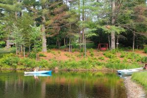 Kayaking on the large pond with cabins in the background