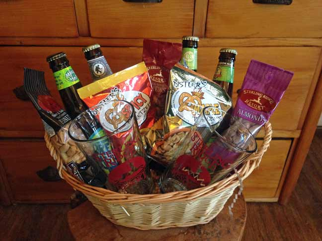 Beer basket with 4 Vermont beers, pint glasses, nuts and vermont pretzels
